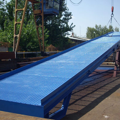 the crane is lifting up blue ramp for the cars, order bespoke mobile loading ramps