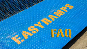 blue ramp with yellow logo of Easyramps and FAQ, container loading ramps