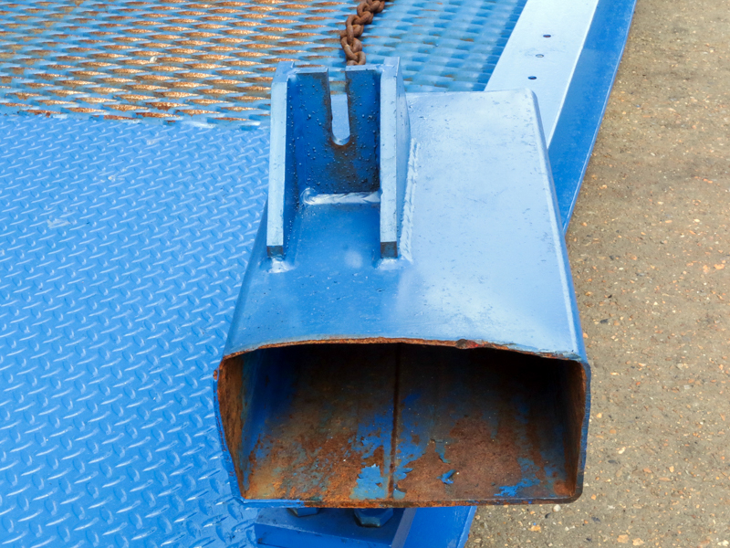 close-up on used blue loading ramps fork clamp