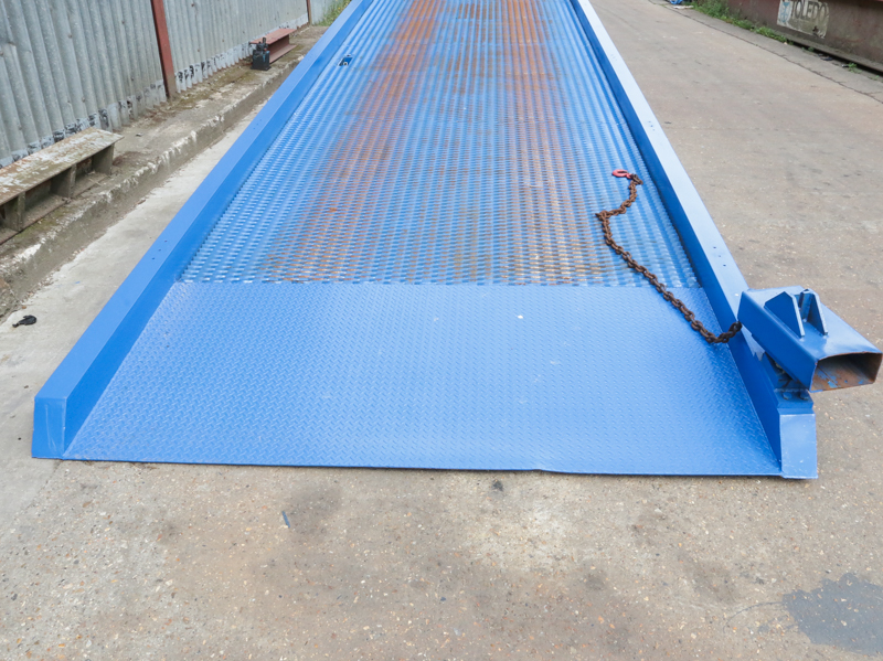 close-up on used blue loading ramp standing on the yard