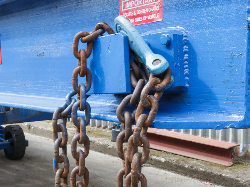 close-up on the blue loading ramp chain
