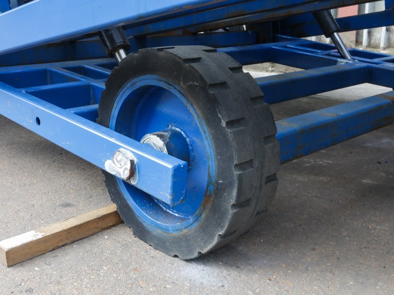 close-up on the blue loading ramp wheel